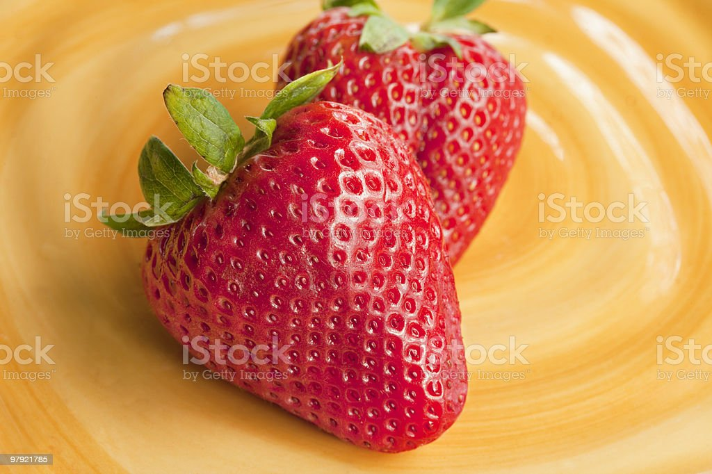 Fresh strawberries on yellow plate royalty-free stock photo