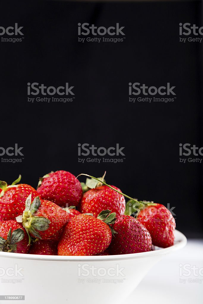 fresh strawberry in white plate on black background royalty-free stock photo