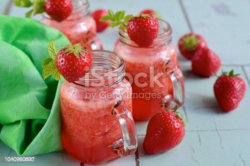 Fresh strawberry juice with mint leaf in a jar