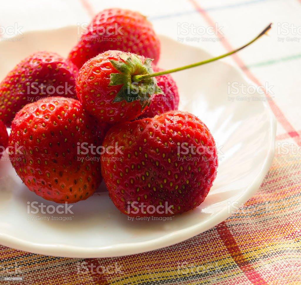 fresh strawberry lying on a white plate closeup royaltyfri bildbanksbilder