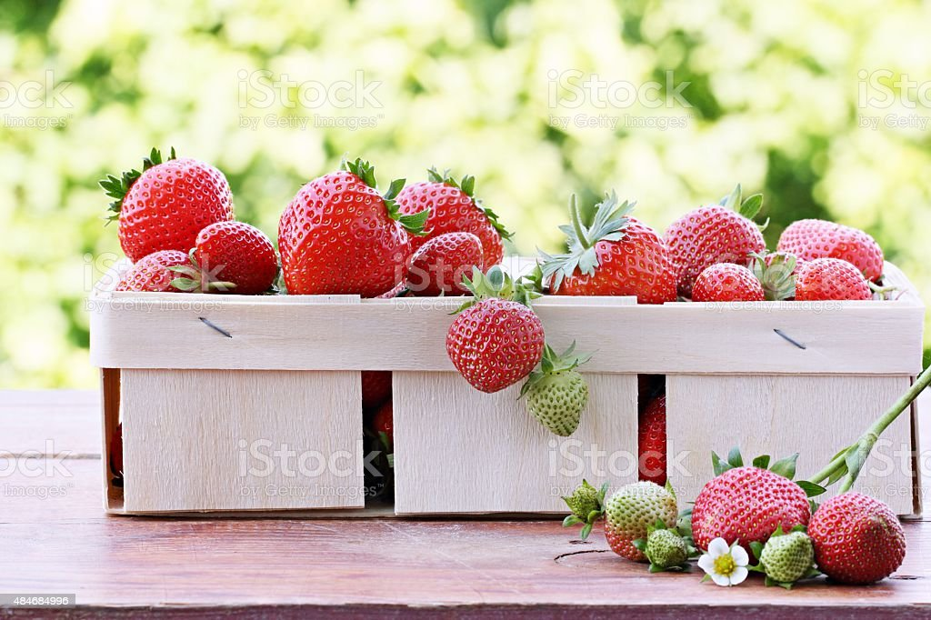 Fresh strawberry on a rustic wooden table. stock photo
