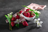 Fresh strawberry  with flowers on black background