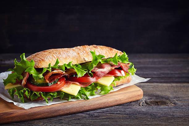 fresco panino submarine - panino ripieno foto e immagini stock