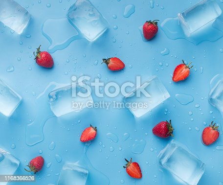 Fresh summer background of strawberries and ice cubes on blue, wallpapers