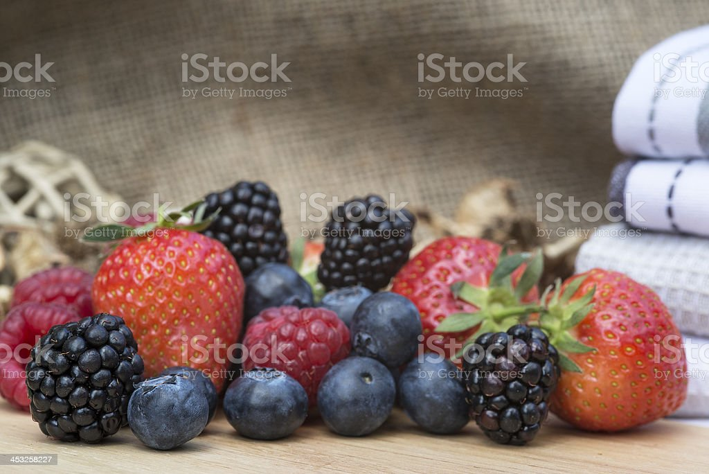 Fresh Summer berries in rustic kitchen setting royalty-free stock photo