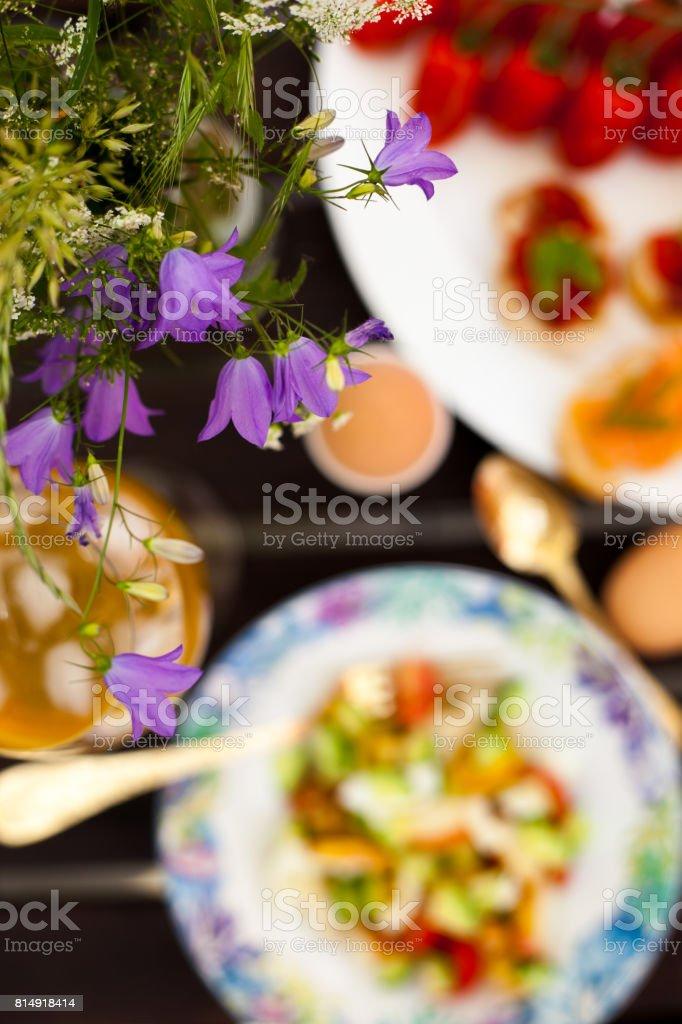Fresh Summer Outdoor Romantic Breakfast in Park with Eggs, Berries, Flowers stock photo