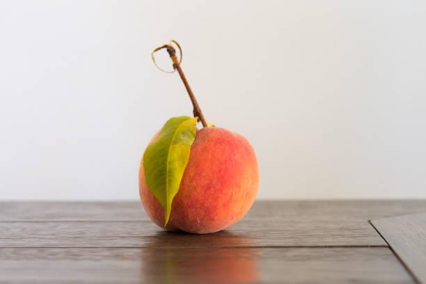 Fresh summer peach on table stock photo