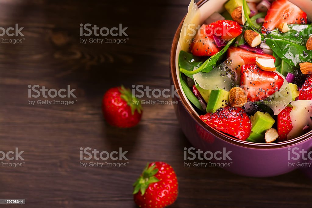 Fresh summer salad with strawberry,avocado and spinach stock photo