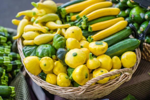 Fresh summer squash at the market stock photo