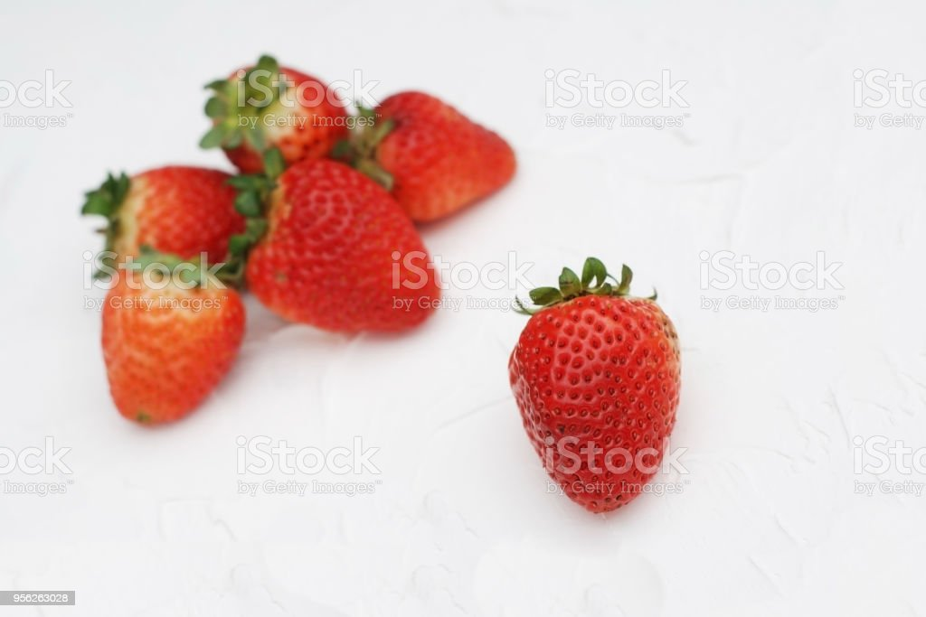 Fresh Summer Strawberries Isolated on Textured Gray Background. Fuits and Vitamines. Health Food Concept. stock photo