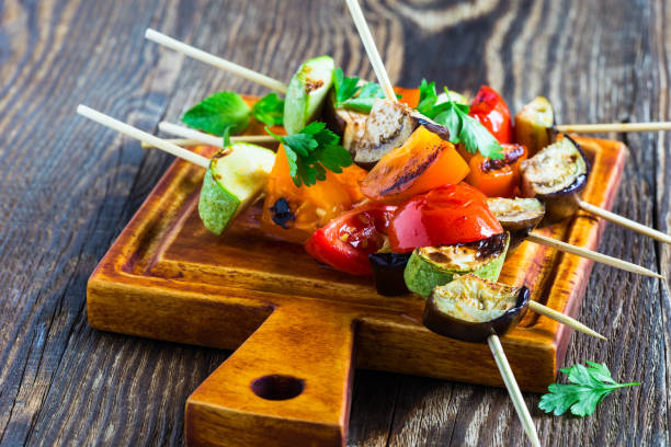 fresh summer vegetable kebabs  with eggplant and cherry tomatoes - grilled vegetables stock photos and pictures