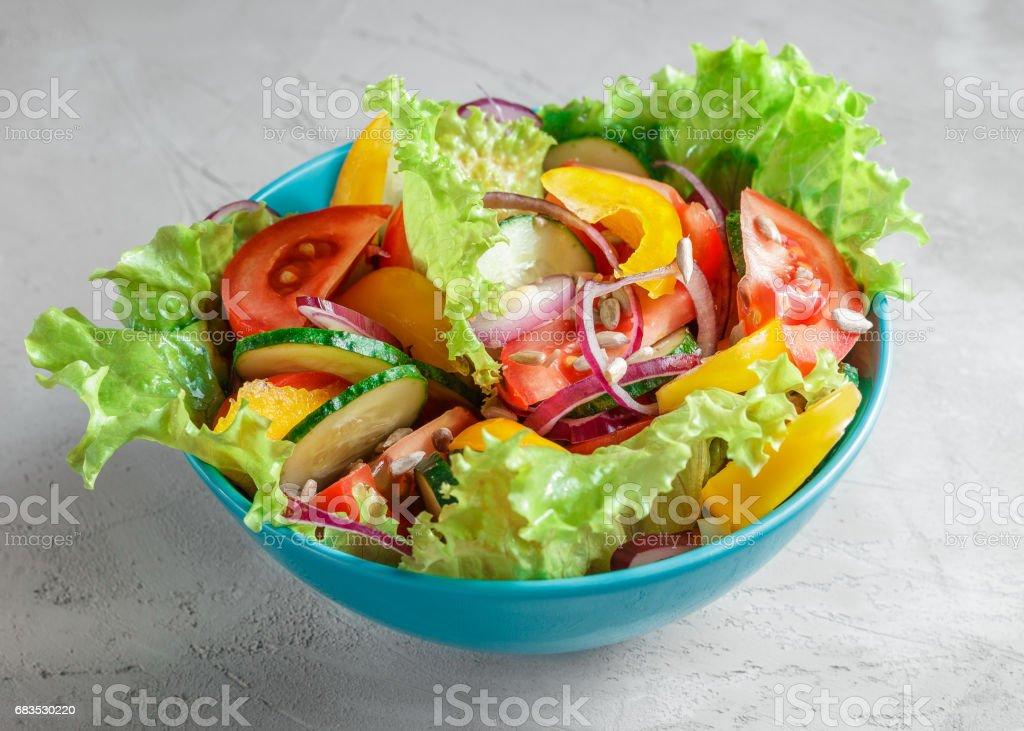 Fresh Summer Vegetable Salad in blue bowl stock photo