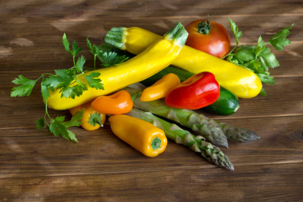 Fresh summer vegetables on a brown wood stock photo