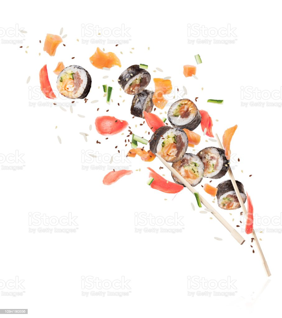 Fresh Sushi Rolls With Chopsticks Frozen In The Air Image In High