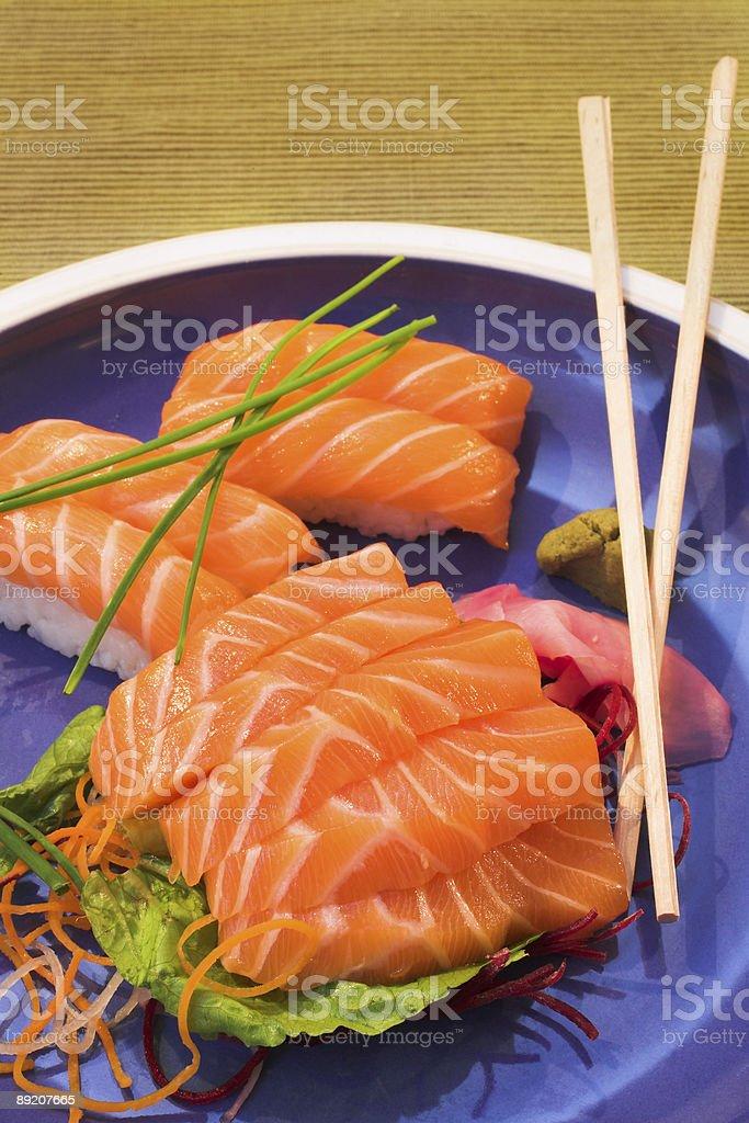 Fresh sushi, sashimi and nigiri salmon on a plate royalty-free stock photo