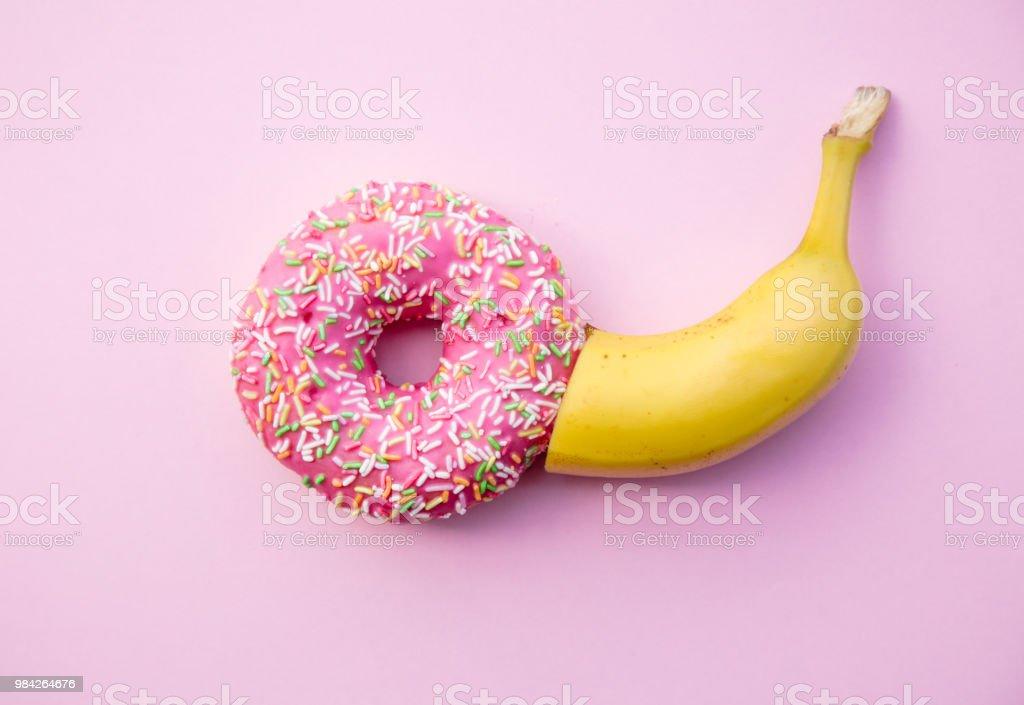 Fresh sweet donut and banana stock photo
