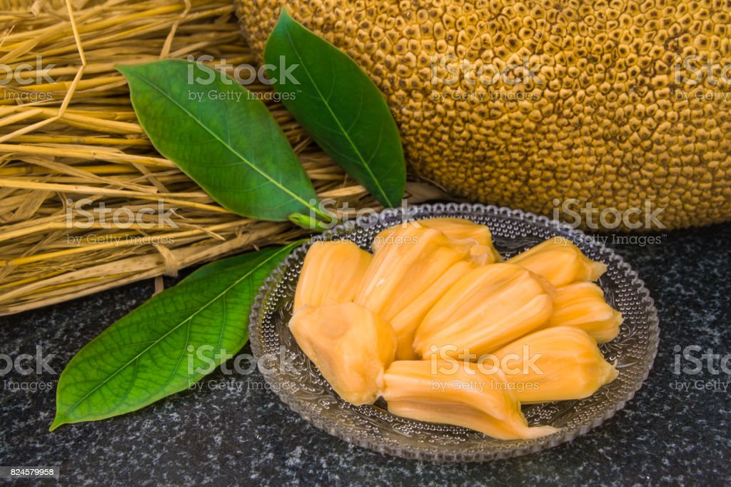 Fresh sweet jackfruit slices on a glass plate ready for eat. stock photo