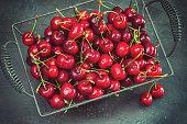 Freshly picked sweet ripe cherries in a basket