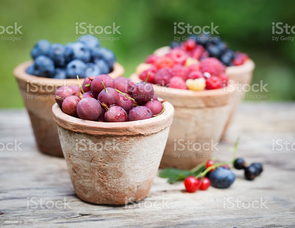 Fresh sweet tasty berries on wooden background royalty-free stock photo
