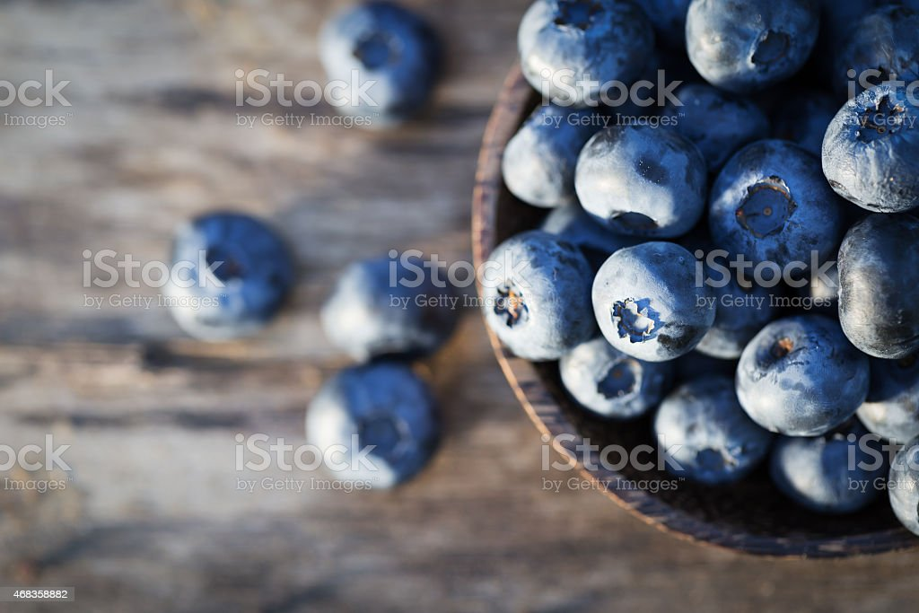 Fresh sweet tasty blueberries on wooden background royalty-free stock photo