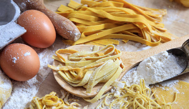 Fresh tagliatelle pasta homemade preparation Fresh pasta homemade preparation uncooked pasta stock pictures, royalty-free photos & images