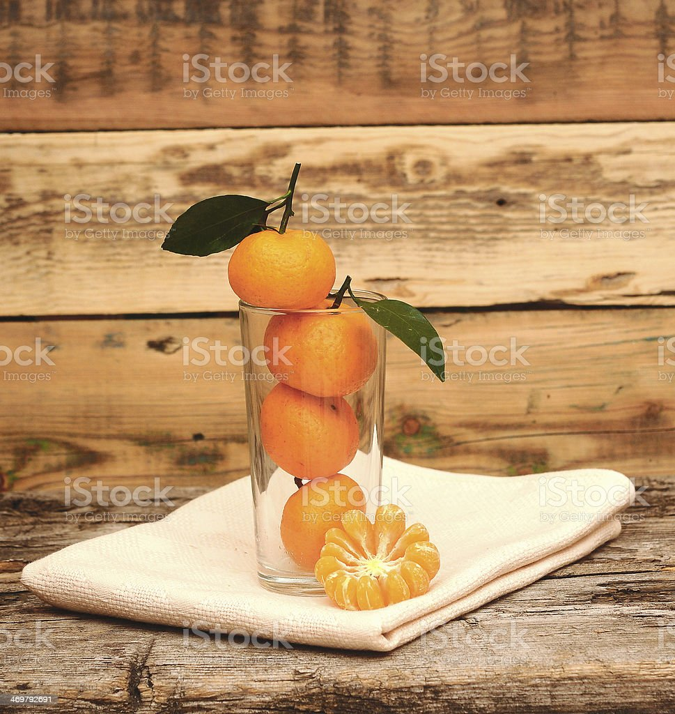 fresh tangerine and segments in a glass royalty-free stock photo