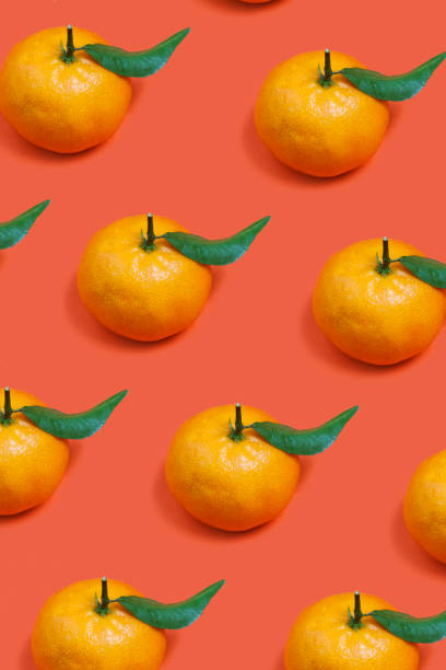 Fresh tangerine Fresh tangerine on orange background tangerine stock pictures, royalty-free photos & images
