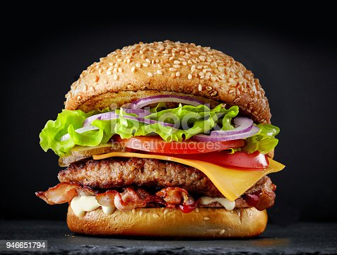 istock fresh tasty burger on dark background 946651794