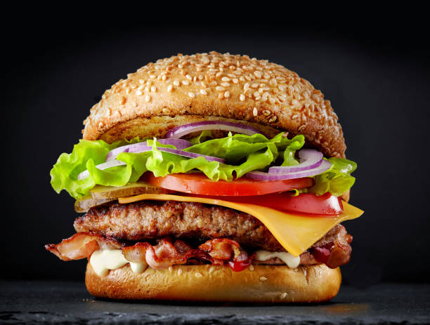 fresh tasty burger on dark background - burgers stock pictures, royalty-free photos & images