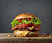 fresh tasty burger on wooden board
