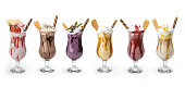 istock Fresh tasty cocktails, Glasses with delicious milk shakes isolated on white background , clipping path included 1036568930