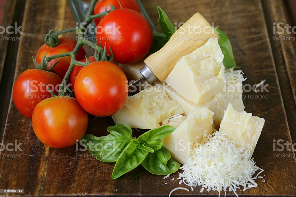 fresh tasty hard parmesan cheese on a wooden board stock photo