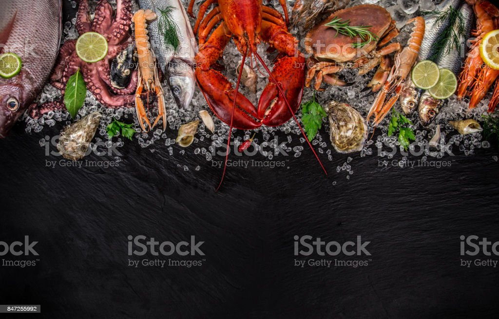 Fresh tasty seafood served on old wooden table stock photo