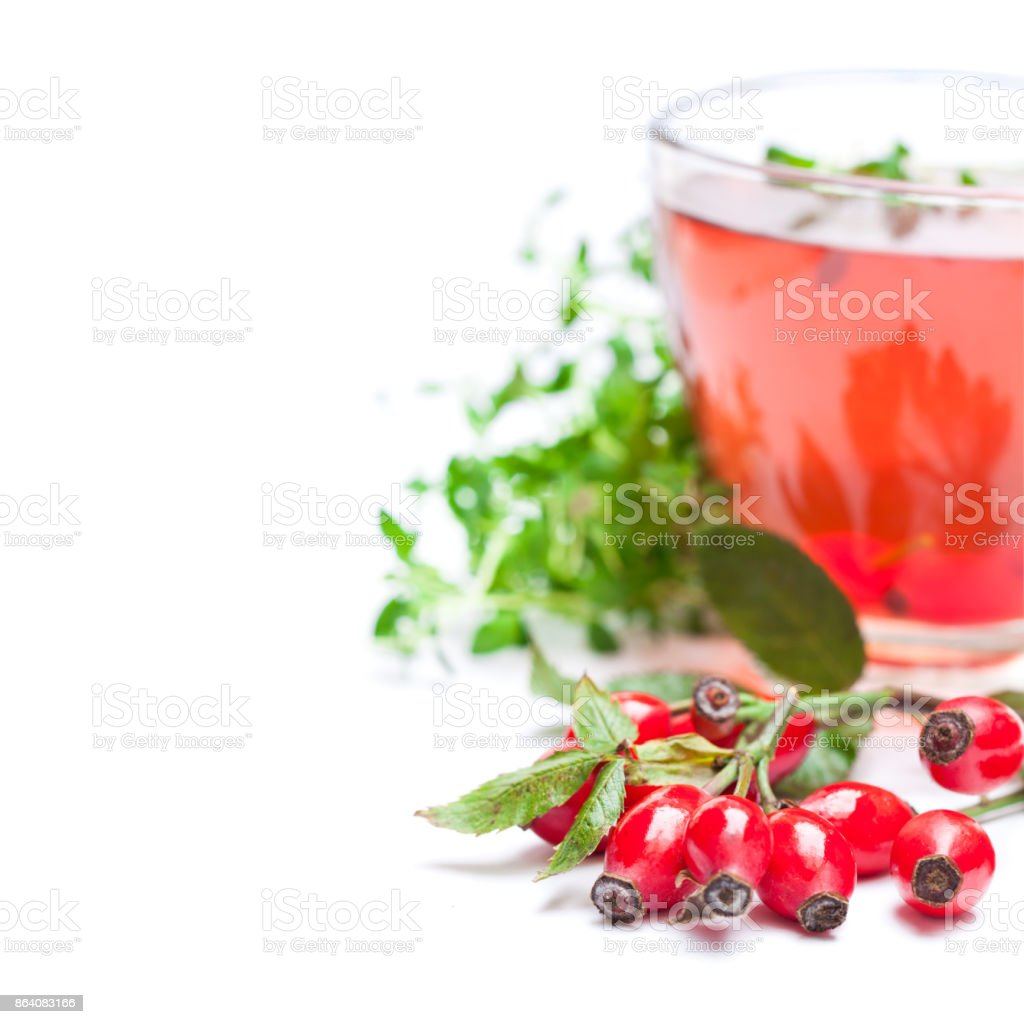 Fresh  tea with rosehip and thyme isolated on white royalty-free stock photo