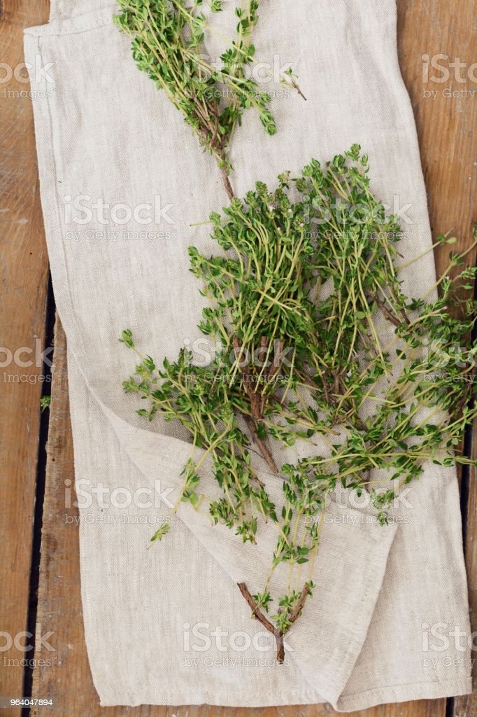 Fresh thyme sprigs on wooden table, top view - Royalty-free Backgrounds Stock Photo