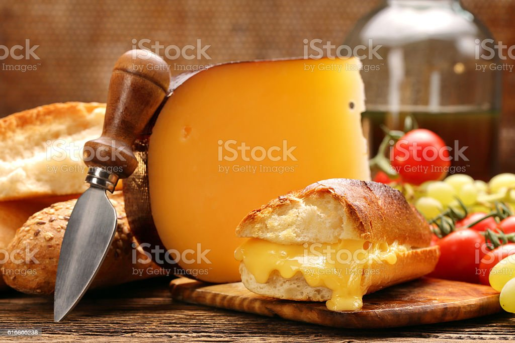 Fresh toast with cheese and herbs on brown vintage background stock photo