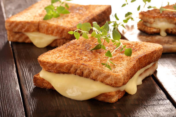 Fresh toast with cheese and herbs stock photo