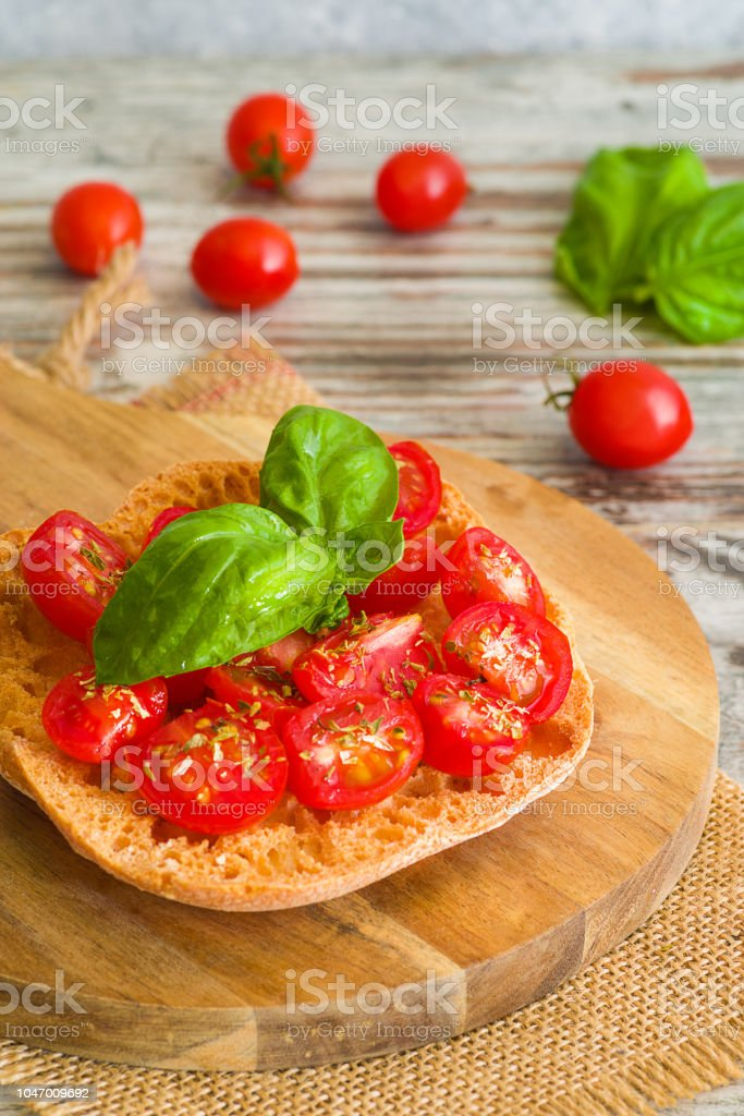 Fresh tomato bruschetta with basil on wooden background. - foto stock