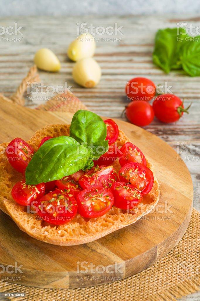 Fresh tomato bruschetta with basil on wooden background. - foto stock
