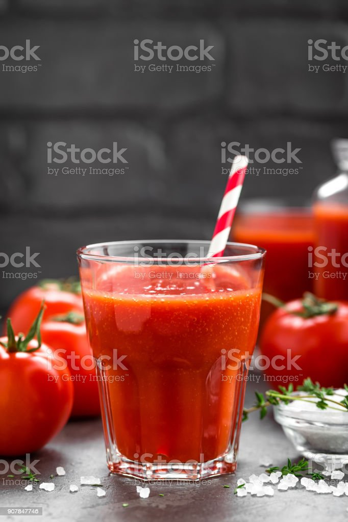 Fresh tomato juice in glass. Vegetable drink stock photo