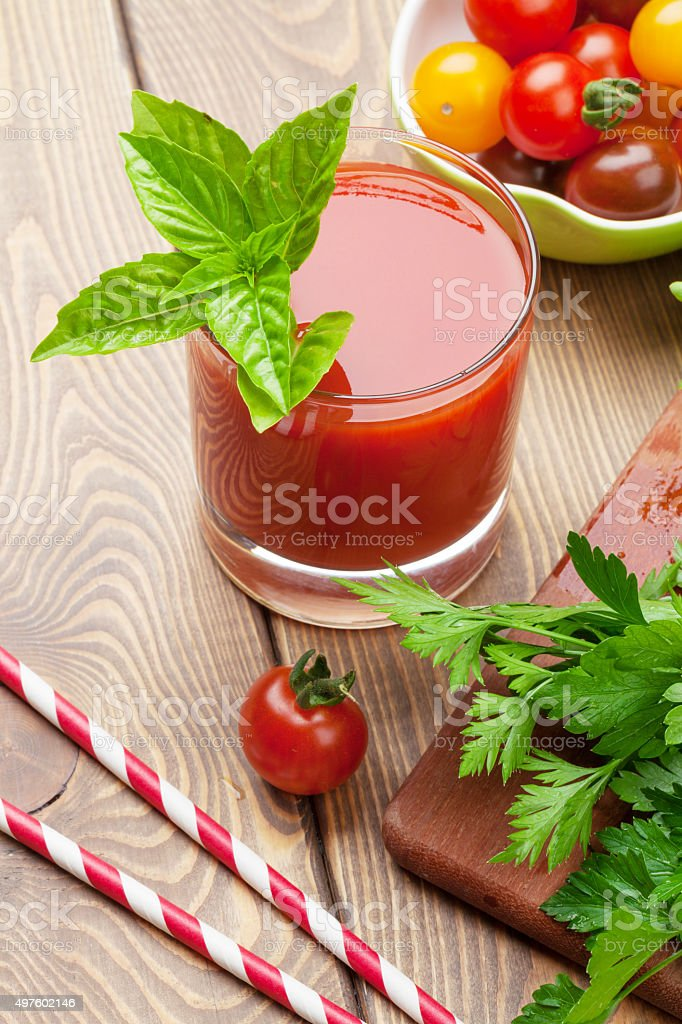 Fresh tomato juice smoothie with basil stock photo