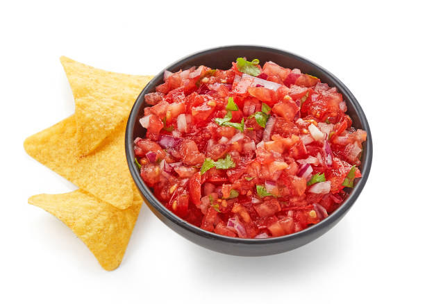 Fresh Tomato salsa with nacho chips isolated on white background Fresh Tomato salsa with nacho chips top view isolated on white background salsa sauce stock pictures, royalty-free photos & images