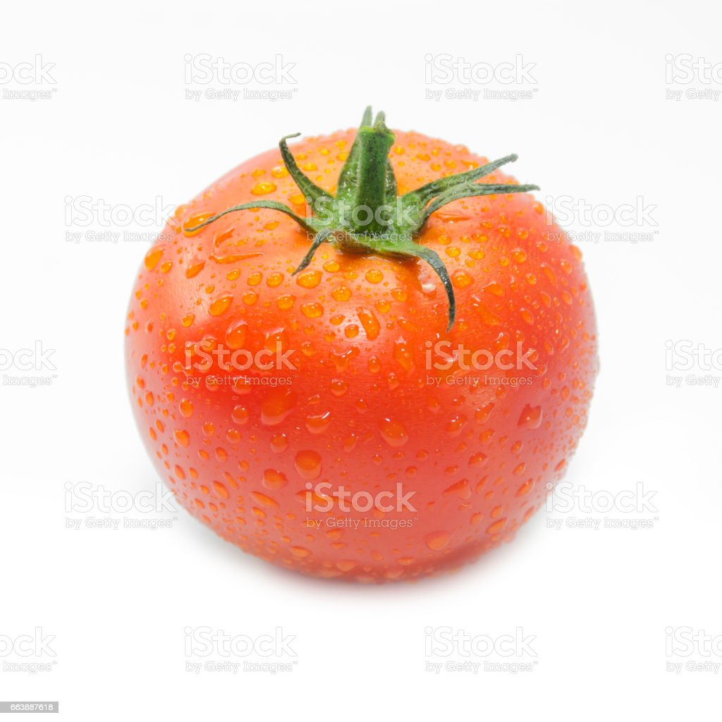 fresh tomato with drops of dew on white background stock photo
