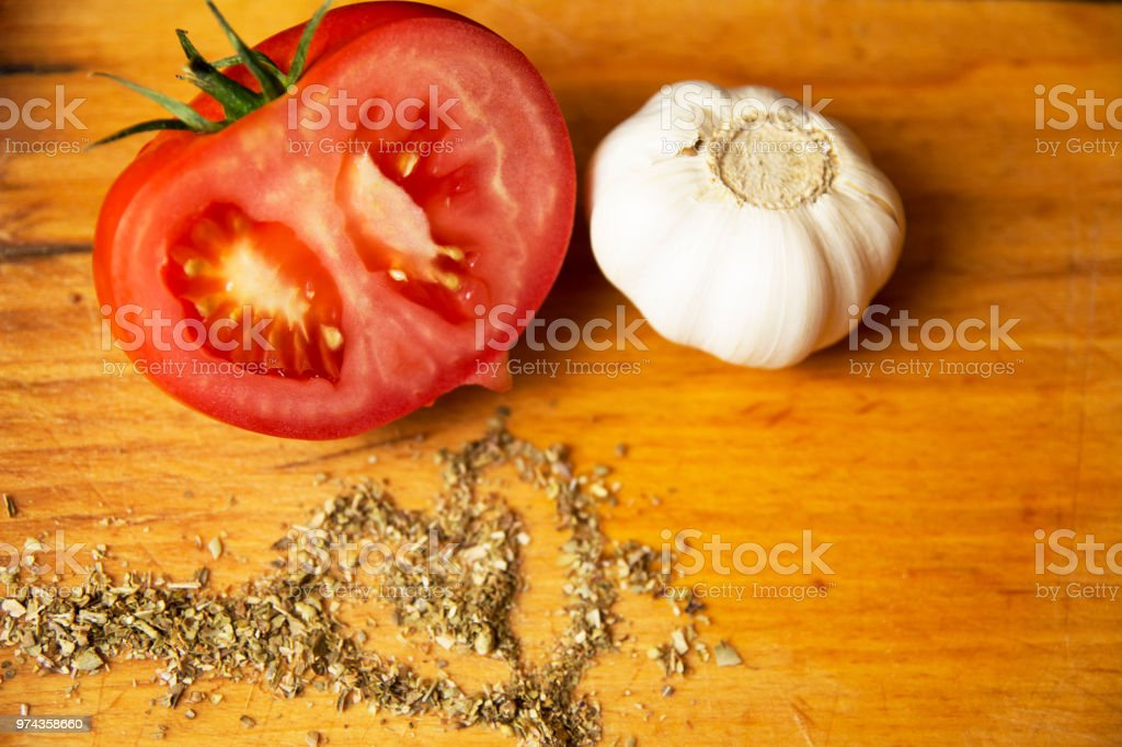 Fresh tomatoe oregano and garlic stock photo