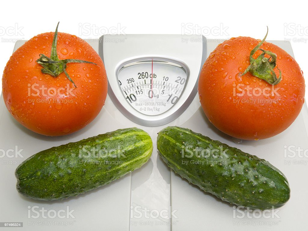 Fresh tomatoes and cucumbers royalty-free stock photo