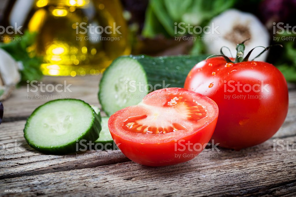 Fresh tomatoes cucumber salad wood vegetable stock photo