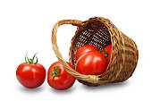 istock Fresh tomatoes in a basket isolated on white background 970271484
