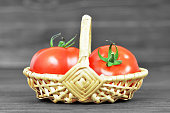 istock Fresh tomatoes in basket on wooden background 970271886