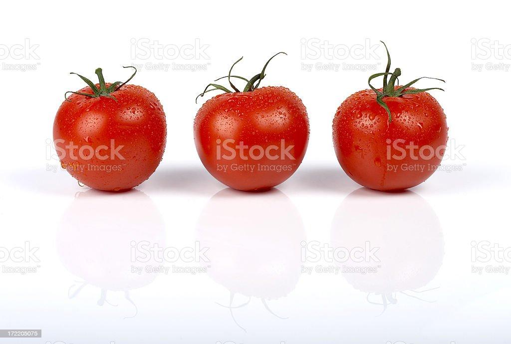 Fresh tomatoes, isolated on white background royalty-free stock photo
