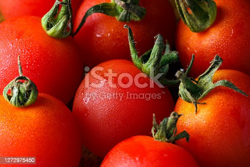 Fresh tomatoes isolated on wooden background